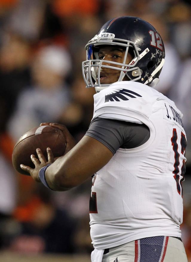Florida Atlantic quarterback Jaquez Johnson warms up before the first half of an NCAA college football game against Auburn on Saturday, Oct. 26, 2013, in Auburn, Ala. (AP Photo/Butch Dill)