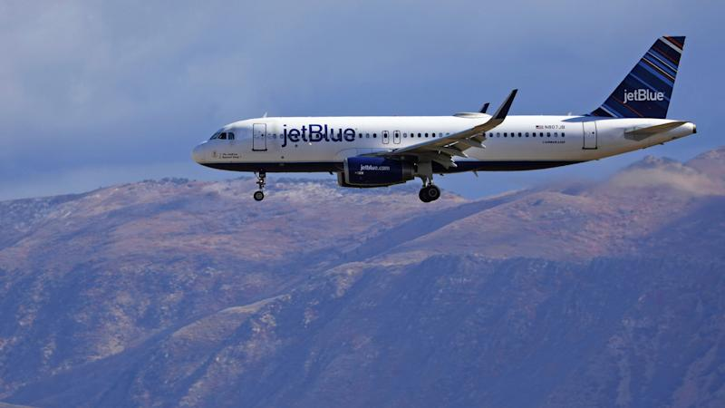 JetBlue's efforts to reduce in-flight waste include a recycling program to sort and recycle bottles and cans served on domestic flights. (Photo: ASSOCIATED PRESS)