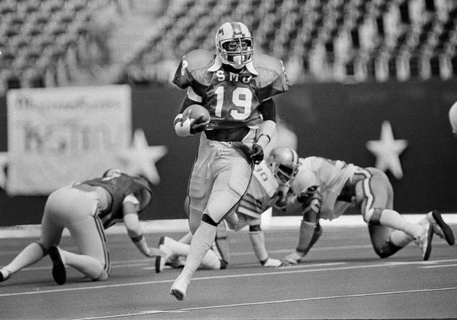 FILE - In this Nov. 7, 1981, file photo, SMU's Eric Dickerson (19) makes his way down the open field during first-half action against Rice in Irving, Texas. A glance at the list of candidates eligible for selection to the College Football Hall of Fame is likely to produce the following reaction: How is that guy not in yet? Dickerson, half of SMUs famed Pony Express backfield, is not in yet. (AP Photo/David Breslauer, File)