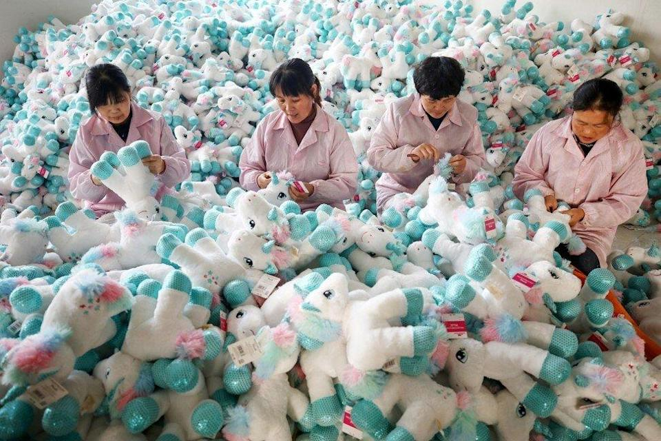 Workers making stuffed toys at a factory in Lizhuang, Ganyu district, ahead of Christmas. Photo: Imaginechina