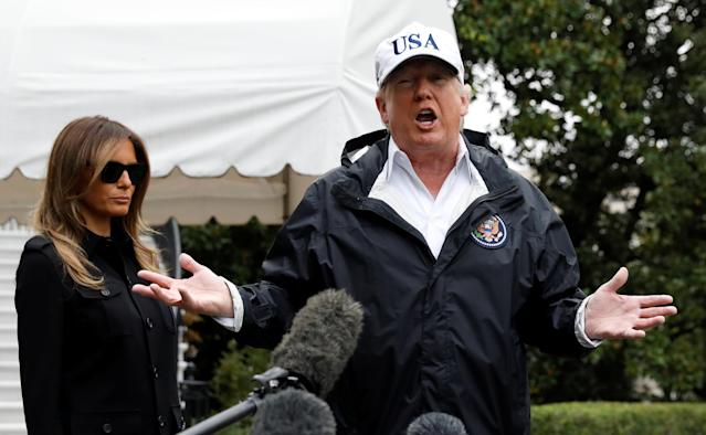 <p>President Donald Trump speaks to reporters as he and First Lady Melania Trump depart the White House in Washington on their way to view storm damage in Fla., Sept.14, 2017. (Photo: Kevin Lamarque/Reuters) </p>