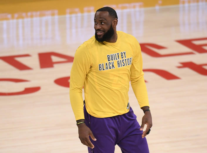 LeBron James in a yellow shirt that reads