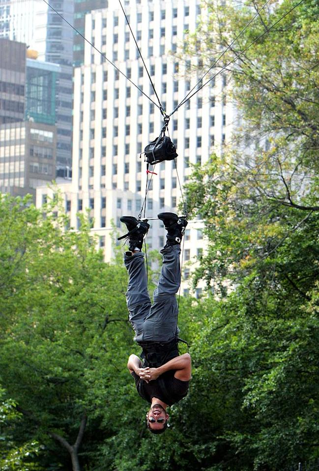 "For his latest ""trick,"" magician/daredevil David Blaine decided to hang upside down in NYC's Central Park for 60 hours. While he completed the stunt, Blaine was unhappy with his grand finale - the Dive of Death - which did not go off according to plan. Steffman/Curd/<a href=""http://www.splashnewsonline.com"" target=""new"">Splash News</a> - September 22, 2008"