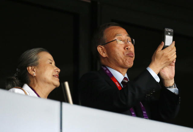 United Nations Secretary-General Ban Ki-moon, right, stands alongside his wife Yoo Soon-taek ahead of the Opening Ceremony at the 2012 Summer Olympics, Friday, July 27, 2012, in London. (AP Photo/Jae C. Hong)