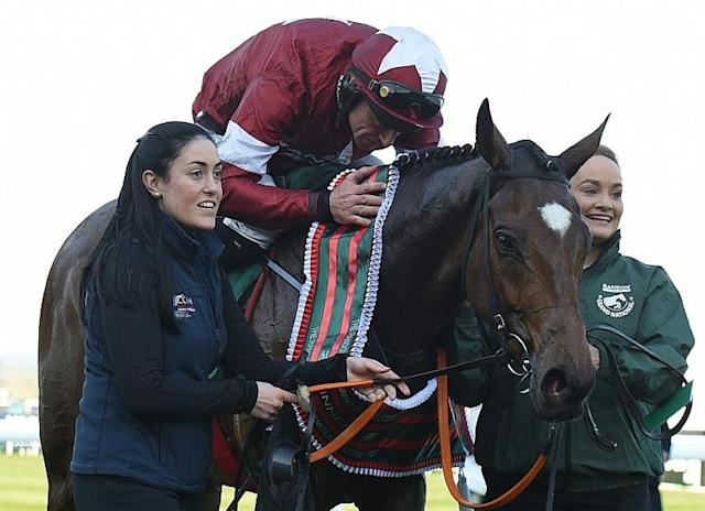 Jockey Davy Russell celebrates after riding Tiger Roll to victory in the 2019 Grand National (AFP Photo/Oli SCARFF )