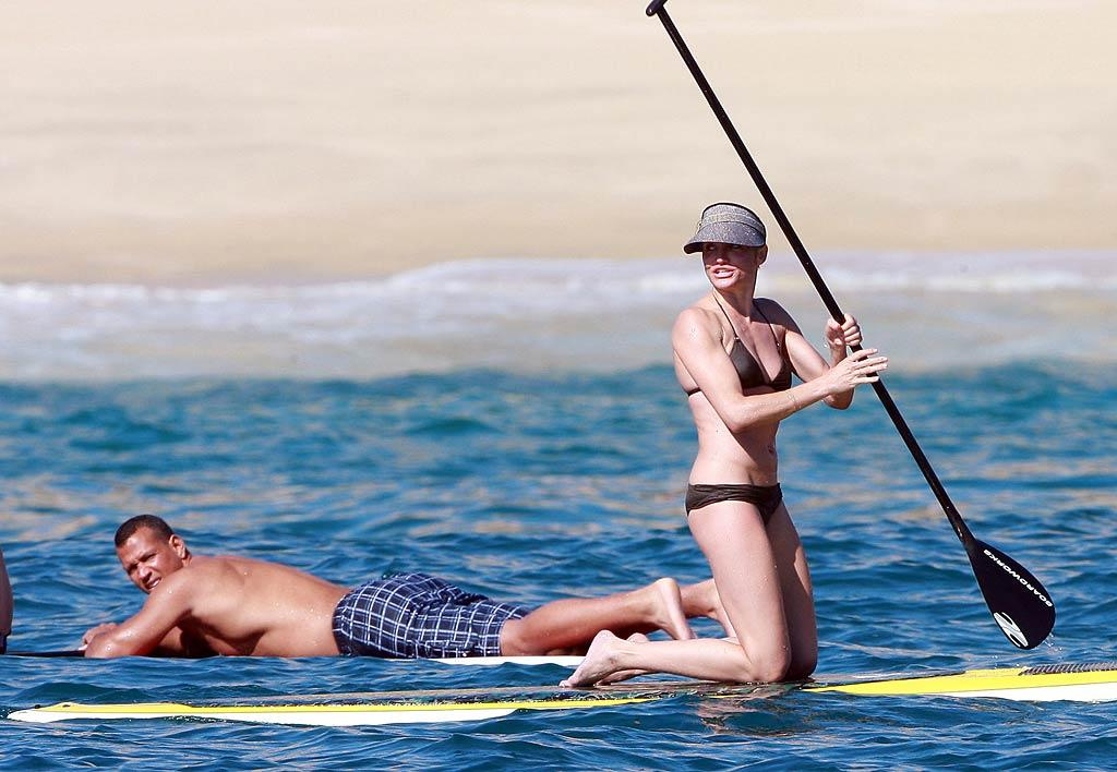 """Celebrating the holidays in style, Cameron Diaz and her beau, New York Yankees slugger Alex Rodriguez, were spotted soaking up the sun while paddleboarding in Los Cabos, Mexico, on Wednesday. The two have been vacationing there all week with A-Rod's two daughters, Natasha and Ella. <a href=""""http://www.infdaily.com"""" target=""""new"""">INFDaily.com</a> - December 22, 2010"""