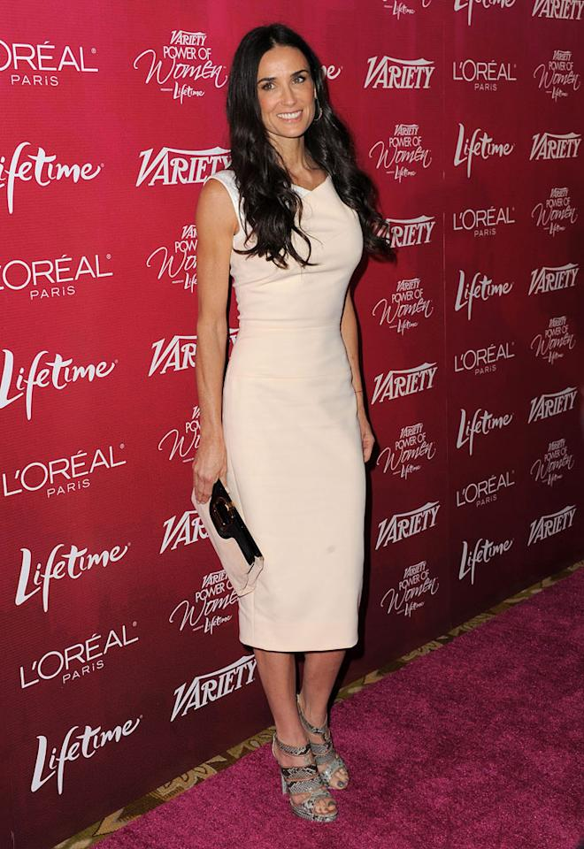 "Ashton Kutcher's better half, Demi Moore, rocked the the red carpet upon arriving at <i>Variety</i>'s 3rd Annual Power Of Women Luncheon. The 48-year-old mom of three looked better than ever in a blush-colored Victoria Beckham frock, snakeskin Alexandre Birman sandals, and lightly-curled tresses. Jordan Strauss/<a href=""http://www.gettyimages.com/"" target=""new"">GettyImages.com</a> - September 23, 2011"