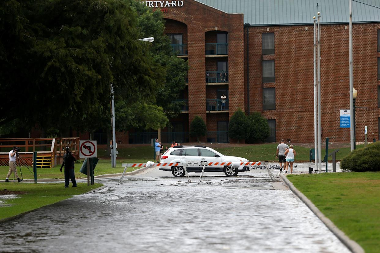 Heavy rain floods a street as the outer bands of Hurricane Florence hit New Bern on Thursday.