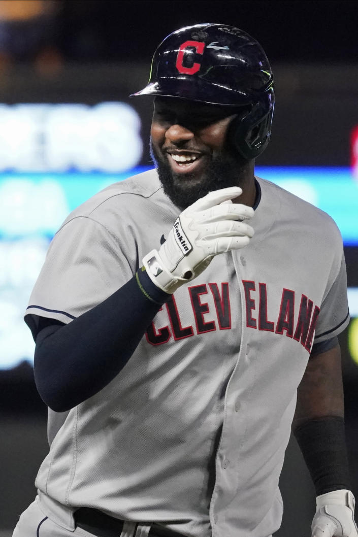 Cleveland Indians' Franmil Reyes smiles after crossing third base on his way home after his solo home run off Minnesota Twins pitcher Andrew Albers in the ninth inning of a baseball game, Wednesday, Sept. 15, 2021, in Minneapolis. The Indians won 12-3. (AP Photo/Jim Mone)
