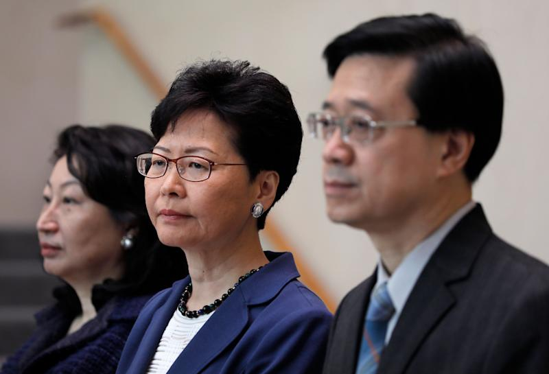 Hong Kong secretary for security John Lee, right, Hong Kong chief executive Carrie Lam, centre, and secretary of justice Teresa Cheng listen to reporters questions during a press conference (Photo: ASSOCIATED PRESS)