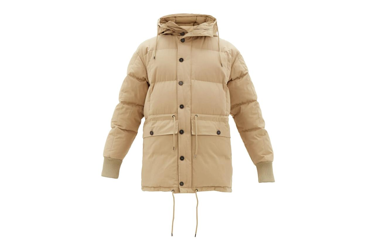 """$867, Matches Fashion. <a href=""""https://www.matchesfashion.com/us/products/Raey-Drawstring-waist-hooded-puffer-jacket-1317201"""">Get it now!</a>"""
