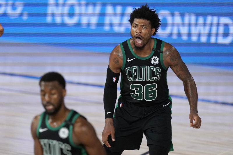 Boston Celtics' Marcus Smart (36) yells to his team after scoring during the first half of an NBA conference semifinal playoff basketball game against the Toronto Raptors' Monday, Sept. 7, 2020, in Lake Buena Vista, Fla. (AP Photo/Mark J. Terrill)