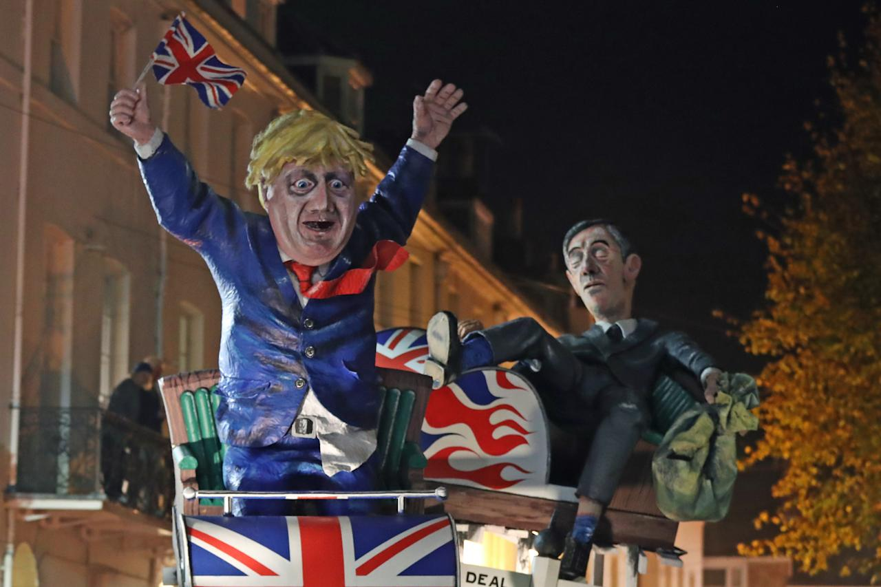An effigy of Prime Minister Boris Johnson and Leader of the House of Commons Jacob Rees-Mogg during the parade through the town of Lewes (PA)