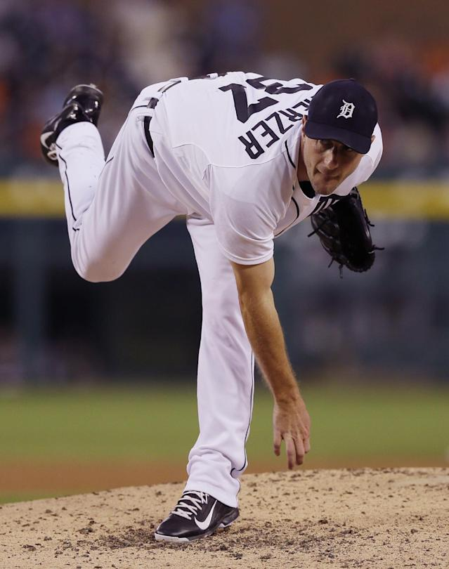 Detroit Tigers starting pitcher Max Scherzer follows through during the fifth inning of a baseball game against the Chicago White Sox, Wednesday, July 30, 2014 in Detroit. (AP Photo/Carlos Osorio)