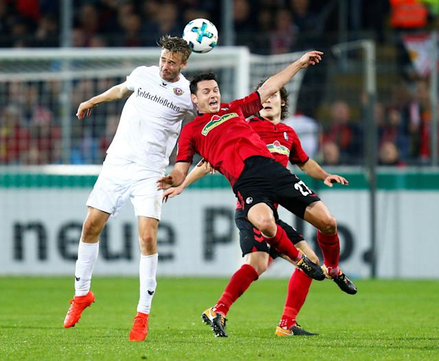 Soccer Football - DFB Cup Second Round - SC Freiburg v Dynamo Dresden - Dreisamstadion, Freiburg, Germany - October 25, 2017 Dynamo Dresden's Lucas Roser in action with SC Freiburg's Nicolas Hofler REUTERS/Ralph Orlowski DFB RULES PROHIBIT USE IN MMS SERVICES VIA HANDHELD DEVICES UNTIL TWO HOURS AFTER A MATCH AND ANY USAGE ON INTERNET OR ONLINE MEDIA SIMULATING VIDEO FOOTAGE DURING THE MATCH.