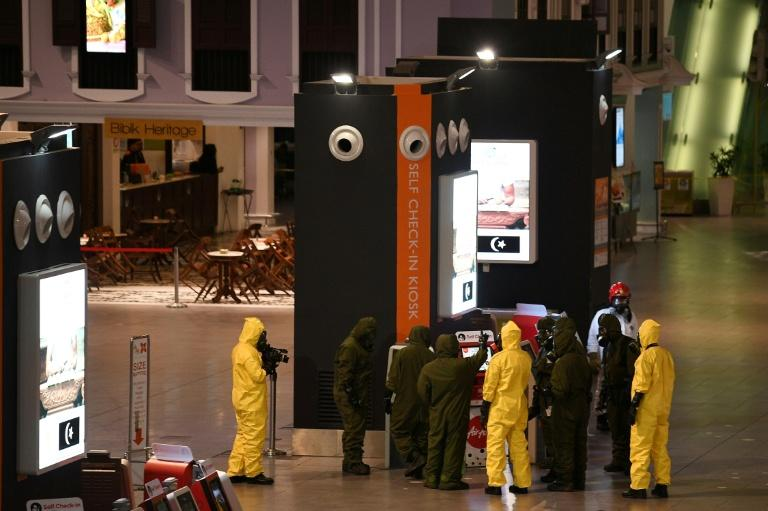 Members of Malaysia's Hazmat team conduct a decontamination operation at the departures terminal of the Kuala Lumpur International Airport on February 26, 2017