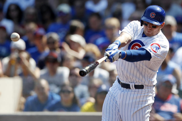 Chicago Cubs' Ryan Sweeney hits a single against the Philadelphia Phillies during the first inning of a baseball game on Sunday, Sept. 1, 2013, in Chicago. (AP Photo/Andrew A. Nelles)
