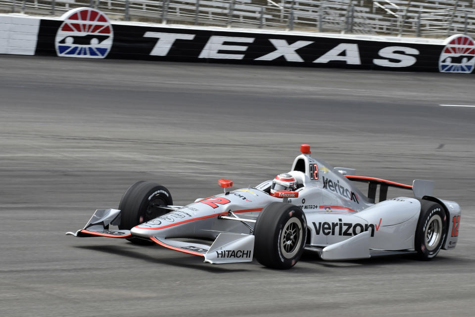 FILE - In this June 9, 2017, file photo, Will Power heads into pit road during qualifying for an IndyCar auto race at Texas Motor Speedway in Fort Worth, Texas. IndyCar has gotten the green flag to finally start its season in Texas. The race will be run June 6 without spectators at Texas Motor Speedway. (AP Photo/Larry Papke, File)