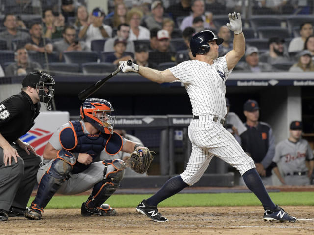 New York Yankees' Brett Gardner, right, hits a two-run home run as Detroit Tigers catcher James McCann, center, and umpire Nic Lentz, left, look on during the sixth inning of a baseball game Friday, Aug. 31, 2018, at Yankee Stadium in New York. (AP Photo/Bill Kostroun)
