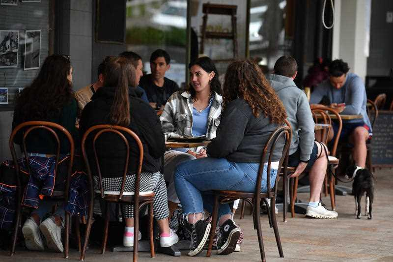 Diners sit a a cafe following 108 days of lockdown at Bronte in Sydney.