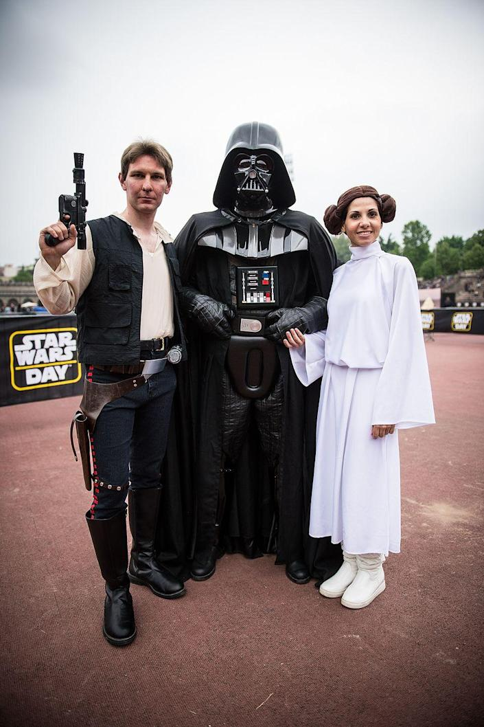 """<p><a href=""""https://www.womansday.com/style/g28692510/star-wars-costume-ideas/"""" rel=""""nofollow noopener"""" target=""""_blank"""" data-ylk=""""slk:Stars Wars costumes"""" class=""""link rapid-noclick-resp""""><em>Stars Wars</em> costumes</a> never out of style, and the force will definitely be with your group if you take on Hans Solo, Darth Vader, and Princess Leia this year.</p><p><a class=""""link rapid-noclick-resp"""" href=""""https://www.amazon.com/Rubies-Star-Darth-Vader-Molded/dp/B0009S6TJ4?tag=syn-yahoo-20&ascsubtag=%5Bartid%7C10070.g.3083%5Bsrc%7Cyahoo-us"""" rel=""""nofollow noopener"""" target=""""_blank"""" data-ylk=""""slk:SHOP DARTH VADER MASK"""">SHOP DARTH VADER MASK</a></p>"""