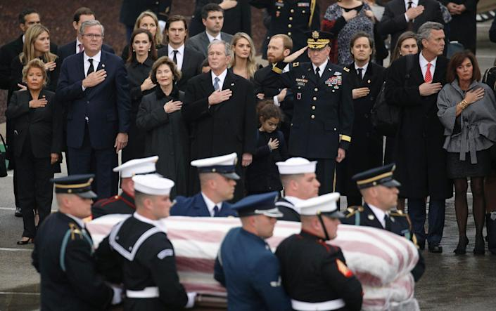 The Bush family looks on as a joint military services honor guard carries the casket for former President George H.W. Bush from the Union Pacific funeral train at Texas A&M University in College Station, Texas, Dec. 6, 2018. (Photo: Loren Elliott/Reuters)