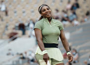 United States Serena Williams smiles after missing a point against Romania's Mihaela Buzarnescu during their second round match on day four of the French Open tennis tournament at Roland Garros in Paris, France, Wednesday, June 2, 2021. (AP Photo/Thibault Camus)