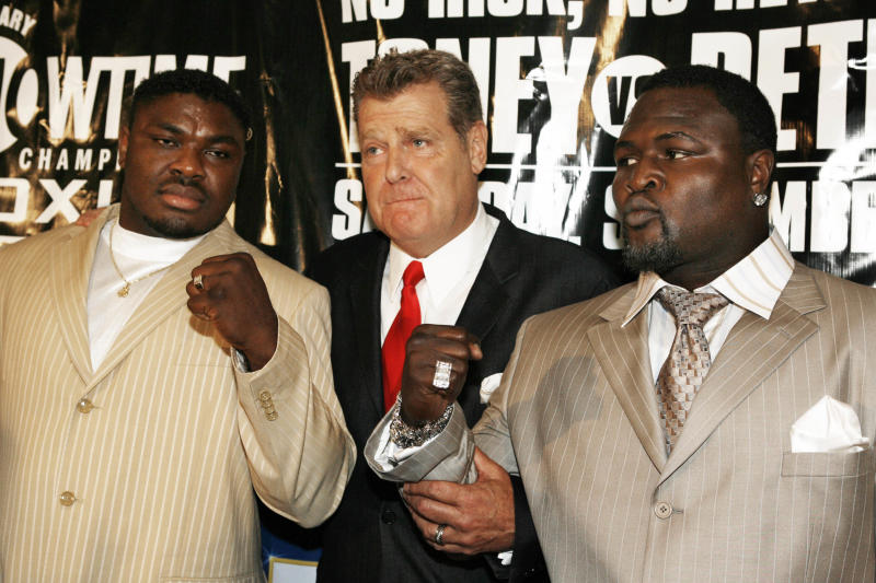 James Toney, right, promoter Dan Goossen, center, and Samuel Peter pose for a photo during a news conference in Los Angeles on Tuesday, July 11, 2006. Toney and Peter will face each other in a WBC boxing heavyweight elimination bout on September 2 at the Staples Center in Los Angeles. (AP Photo/Nick Ut)