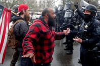 Supporters of U.S. President Donald Trump confront police at a rally in support of Trump at the Oregon State Capitol in Salem