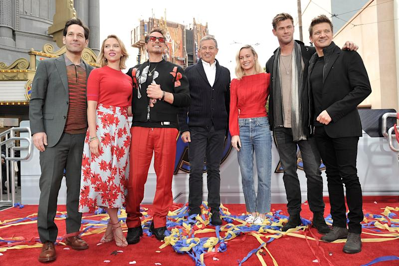"""Avengers: Endgame"" cast members, Paul Rudd, from left, Scarlett Johansson, Robert Downey Jr., Robert Iger, Brie Larson, Chris Hemsworth and Jeremy Renner appear at an event announcing the Universe Unites Charity at Disney California Adventure Park on Friday, April 5, 2019, in Anaheim, Calif. (Photo by Richard Shotwell/Invision/AP)"