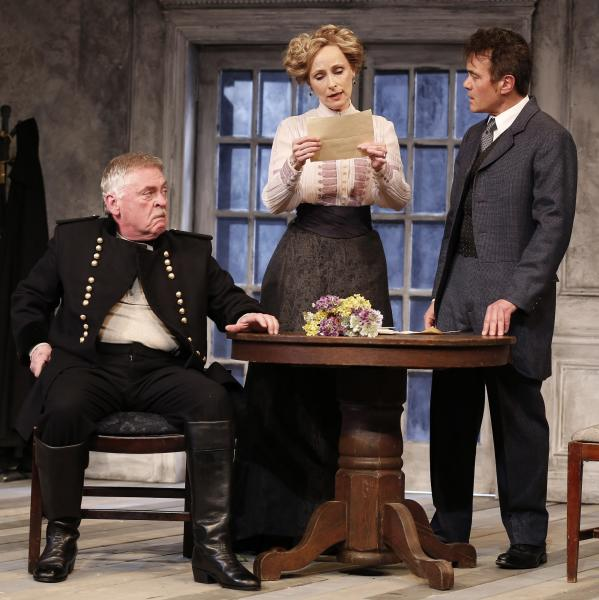 """This theater publicity image released by David Gersten & Associates shows, from left, Daniel Davis, Laila Robins and Derek Smith, in a scene from the Red Bull Theater adaptation of August Strindberg's """"Dance of Death"""", currently performing off-Broadway at the Lucille Lortel Theatre in New York. (AP Photo/David Gersten & Associates, Carol Rosegg)"""