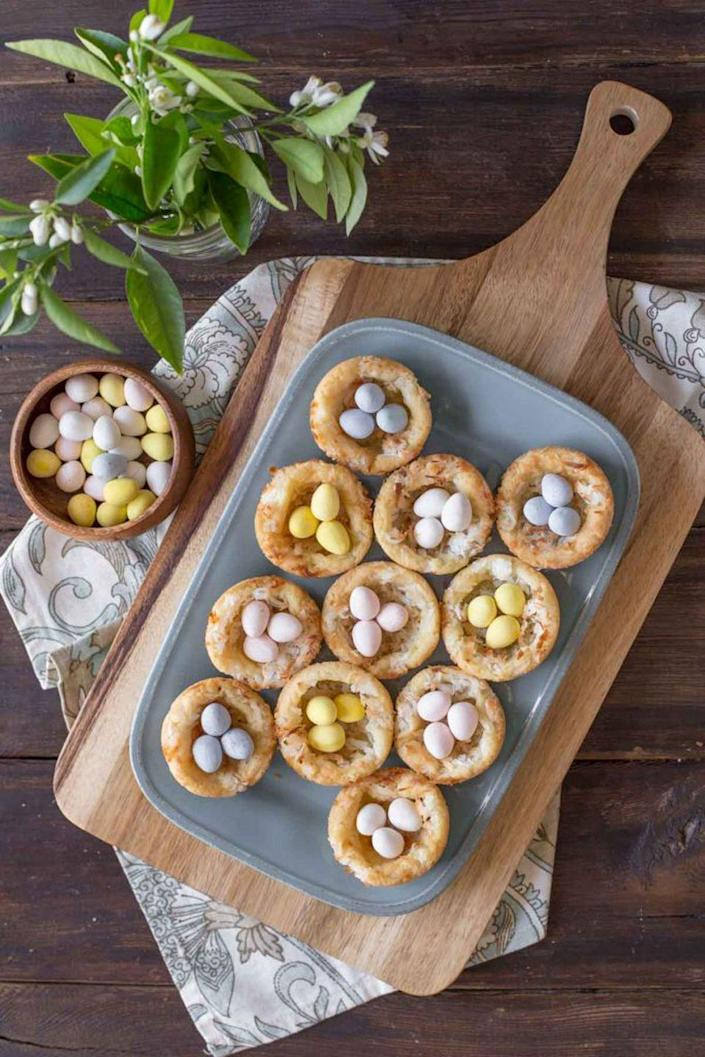 """<p>These coconut nests are an adorable addition to any Easter dessert table. </p><p><em><a href=""""https://lovelylittlekitchen.com/sugar-cookie-easter-egg-nests/"""" rel=""""nofollow noopener"""" target=""""_blank"""" data-ylk=""""slk:Get the recipe from Lovely Little Kitchen »"""" class=""""link rapid-noclick-resp"""">Get the recipe from Lovely Little Kitchen »</a></em> </p>"""