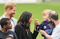 <p>During their visit to Ireland in July 2018, the couple met with an adorable child who tried to steal some of the duchess' hair. I mean, you can't blame them! </p>