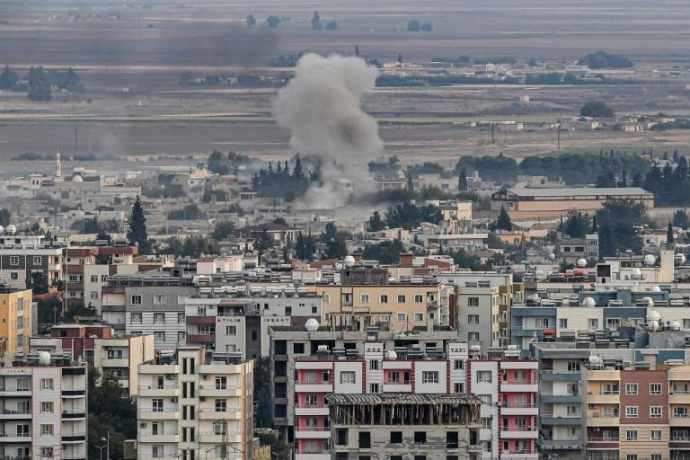 The ethnically divided Kurdish-held border town of Ras al-Ain in Syria is one of the key targets of Turkey's invasion and has come under heavy bombardment (AFP Photo/Ozan KOSE)