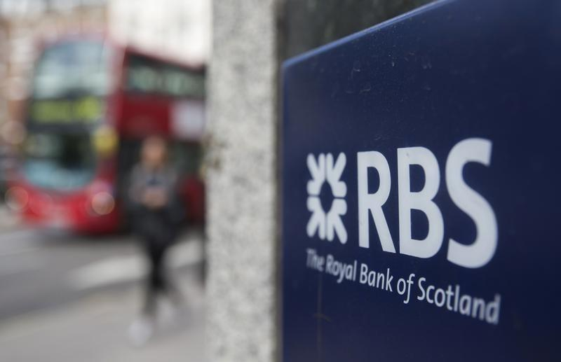 A sign is displayed outside of a branch of The Royal Bank of Scotland in central London