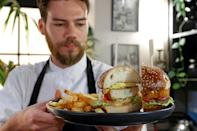 Israeli chef Shachar Yogev serves a burger made with 'cultured chicken' meat