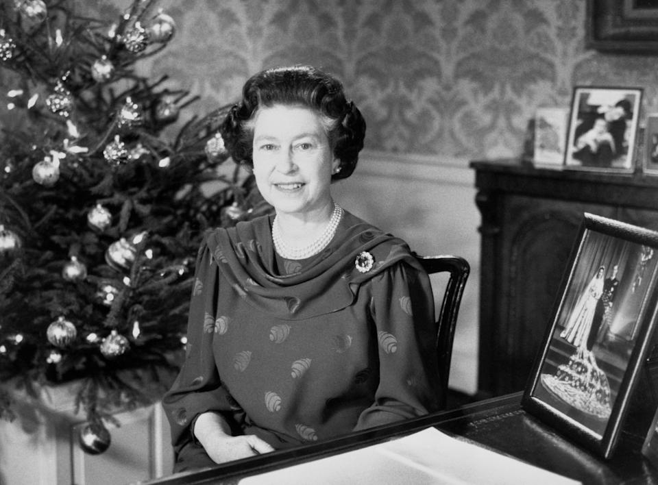 The Queen makes her traditional Christmas Day address to the nation and the Commonwealth in 1987. The broadcast was produced by Sir David Attenborough. (PA Images)