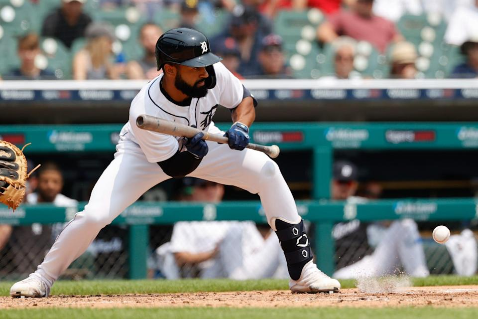 Detroit Tigers center fielder Derek Hill (54) bunt for a single in the third inning against the Minnesota Twins at Comerica Park on July 18, 2021.