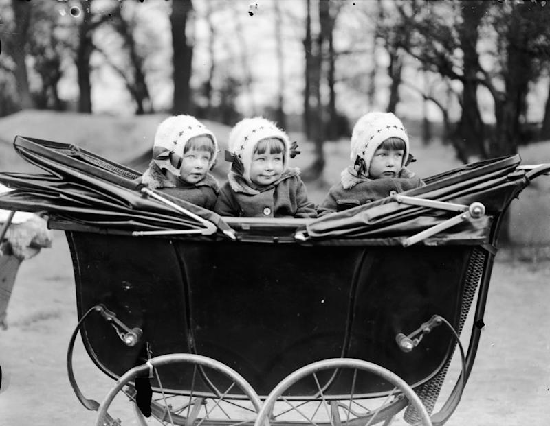 April 1929: Triplets at Leytonstone, London. (Photo by Smith/Fox Photos/Getty Images)