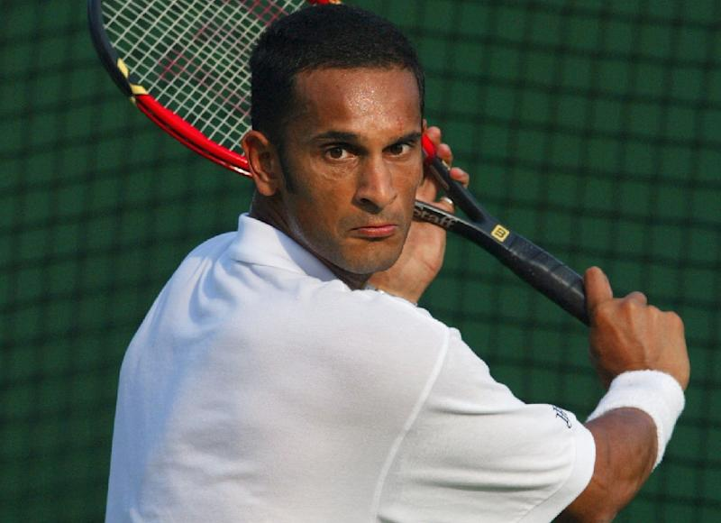 Britain's Arvind Parmar, a former Davis Cup player, said he was once offered an envelope stuffed with cash to throw a match (AFP Photo/Thomas Coex)