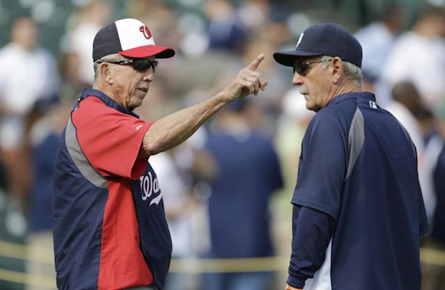 Washington Nationals manager Davey Johnson, left, talks with Detroit Tigers manager Jim Leyland before their baseball game in Detroit, Tuesday, July 30, 2013. (AP Photo/Carlos Osorio)