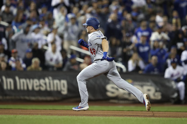 Los Angeles Dodgers' Gavin Lux runs the bases after hitting a three-run home run during the fourth inning of the team's baseball game against the New York Mets, Friday, Sept. 13, 2019, in New York. (AP Photo/Mary Altaffer)