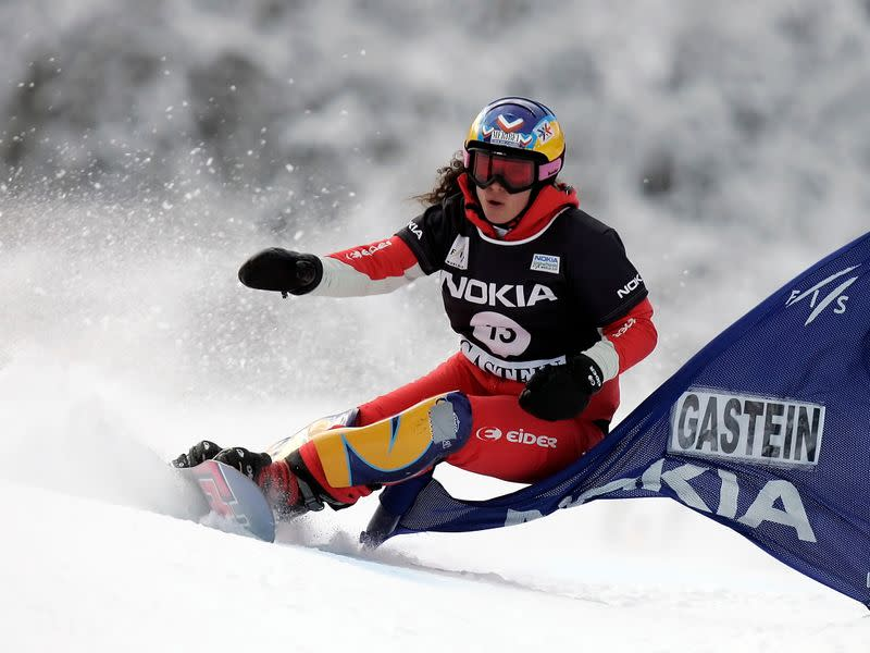FILE PHOTO: France's Pomagalski takes a curve during the final heat of the parallel giant slalom race at the Snowboard World Cup in Bad Gastein
