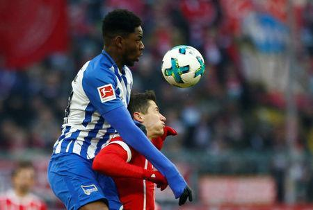 Soccer Football - Bundesliga - Bayern Munich vs Hertha BSC - Allianz Arena, Munich, Germany - February 24, 2018 Hertha Berlin's Jordan Torunarigha in action with Bayern Munich's Robert Lewandowski REUTERS/Michaela Rehle