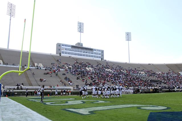 A sparse but enthusiastic crowd watches Jackson State during an NCAA college football scrimmage, Saturday, Oct. 19, 2013, in Jackson, Miss. Jackson State decided to continue with homecoming festivities after Saturday's NCAA college football game game against Grambling State was cancelled because disgruntled Grambling players refused to travel to Jackson. (AP Photo/Charles Smith)