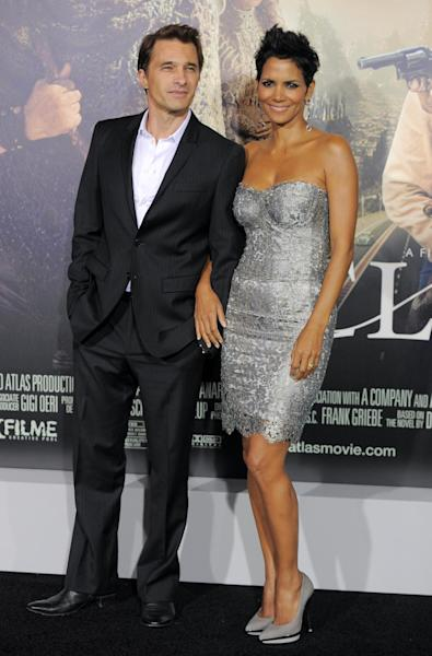 "FILE - This Oct. 24, 2012 file photo shows actors Olivier Martinez, left, and Halle Berry at the Los Angeles premiere of Berry's film, ""Cloud Atlas,"" in the Hollywood section of Los Angeles. A representative for the 46-year-old actress confirms that Berry and her fiance, Olivier Martinez, are expecting their first child together. Berry and Martinez announced their engagement last year. Berry has a four-year-old daughter, Nahla, with ex-boyfriend Gabriel Aubry. (Photo by Chris Pizzello/Invision/AP, file)"