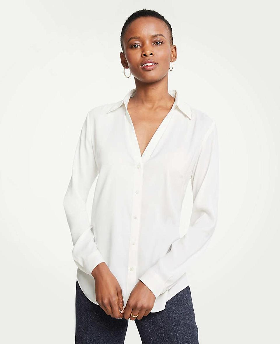 """<h2>Ann Taylor Petite Essential Shirt</h2><br><strong>The Best White Button-Down For Petites</strong><br>A near-unanimous declaration of perfection is rare, but Ann Taylor's <a href=""""https://www.anntaylor.com/petite-essential-shirt/484090?skuId=26082622&defaultColor=9192&catid=cata000026"""" rel=""""nofollow noopener"""" target=""""_blank"""" data-ylk=""""slk:Petite Essential Shirt"""" class=""""link rapid-noclick-resp"""">Petite Essential Shirt</a> has an almost flawless rating, and we can see why. With a silky fabrication and a dipped neckline, this shirt has the sought-after ability to transition from day to night, and elevate pretty much any outfit.<br><br><strong>The Hype:</strong> 4.7 out of 5 stars, 93 reviews on Ann Taylor<br><br><strong>What They're Saying: </strong>""""Lightweight and versatile!!!! I am normally a PS (5'1, 124, 36C) but went with the PM to ensure no gapping.""""<br><br><strong>Ann Taylor</strong> Petite Essential Shirt, $, available at <a href=""""https://go.skimresources.com/?id=30283X879131&url=https%3A%2F%2Fwww.anntaylor.com%2Fpetite-essential-shirt%2F484090%3FskuId%3D26082622%26defaultColor%3D9192%26catid%3Dcata000026"""" rel=""""nofollow noopener"""" target=""""_blank"""" data-ylk=""""slk:Ann Taylor"""" class=""""link rapid-noclick-resp"""">Ann Taylor</a>"""