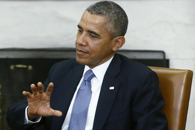 President Barack Obama answers a question about the looming federal government shutdown from a reporter during his meeting with Israeli Prime Minister Benjamin Netanyahu in the Oval Office of the White House in Washington, Monday, Sept. 30, 2013. (AP Photo/Charles Dharapak)