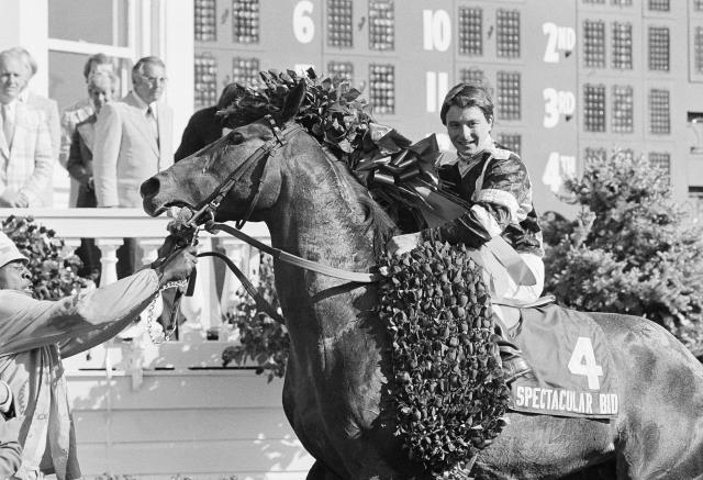 FILE - In this May 5, 1979, file photo, Spectacular Bid, with jockey Ronnie Franklin up, wears the blanket of roses in the winner's circle after winning the Kentucky Derby horse race at Churchill Downs in Louisville, Ky. Franklin, who rode Spectacular Bid to victory in the 1979 Kentucky Derby and Preakness, has died. He was 58. Franklin's nephew, Walter Cullum, said the former Maryland-based jockey died of lung cancer on Thursday, March 8, 2018. (AP Photo/File)