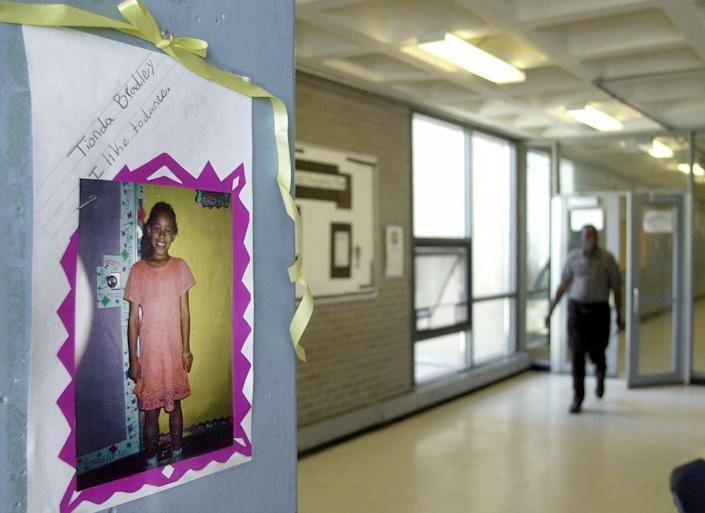 A photo of of Tionda Bradley, 10, hangs in a hallway Wednesday, July 11, 2001, where the Chicago youngster attended summer school.